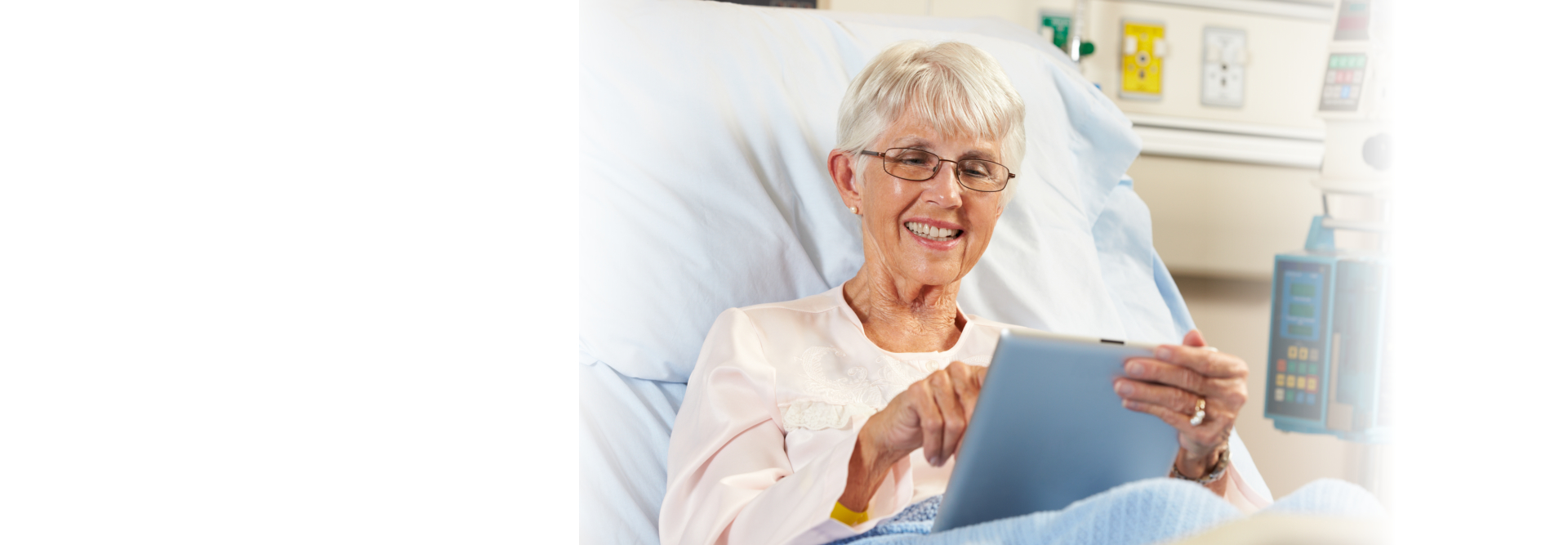 elderly woman using tablet